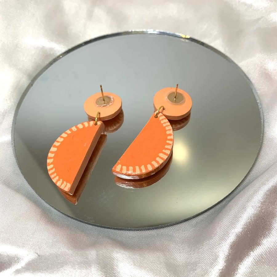 Image of orange slice dangles