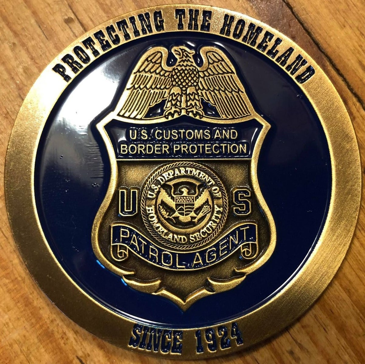 Image of CBP ~ THE HUNTING OF MAN COMMEMORATIVE COIN