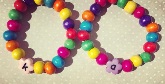 Image of Flower initial rainbow bracelet
