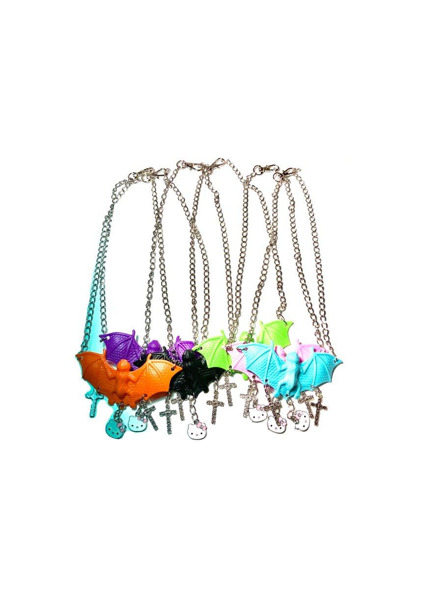 Image of Purple Bat Hello Kitty Cross Necklace