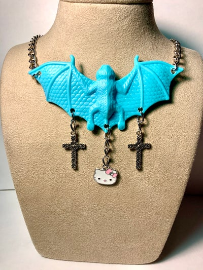 Image of Blue Bat Hello Kitty Cross Necklace