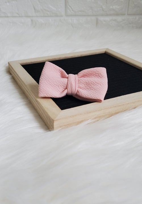 Image of Real men wear pink bowtie