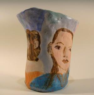 A Few Pensive Faces Vase