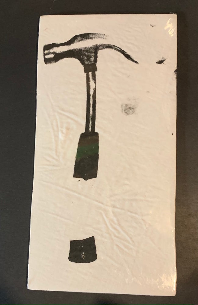 Image of The Damage Manual Hammer Scenery Piece