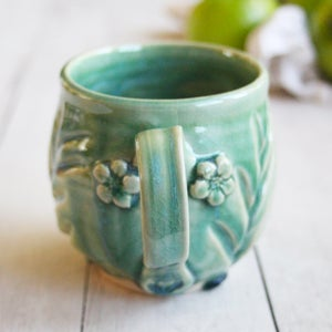 Image of Shimmering Green Glazed Mug with Floral Design, 15 ounce, Handmade Pottery Made in USA