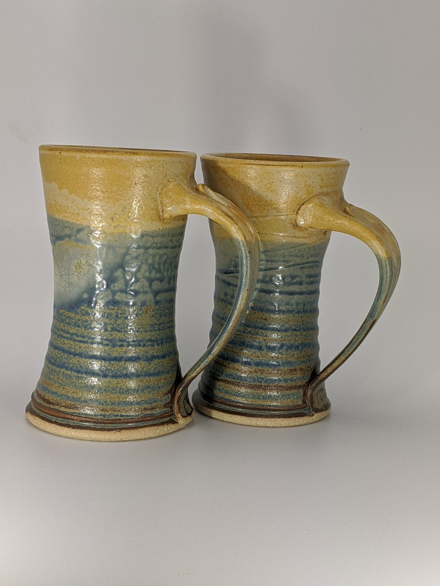 Image of Pair of blue and orange steins