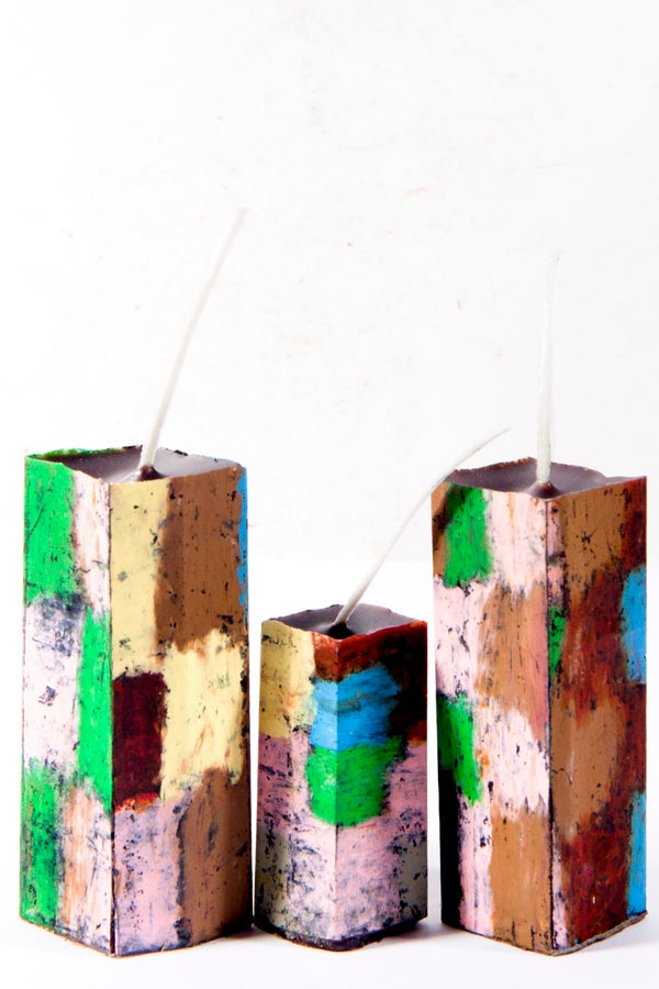 Image of Stack Tower Family in green, black, soft yellow, deep red, brown, pink, grey & blue