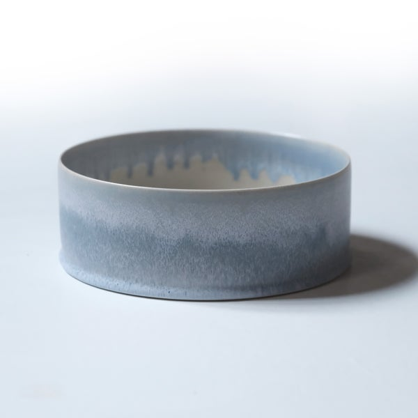 Image of UNIKA CYLINDER BOWL IN FROSTED LIGHT BLUE GLAZE AND  GLOSSY TRANSPARENT GLAZE INTERIOR