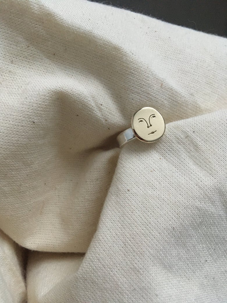 Image of small sun face ring