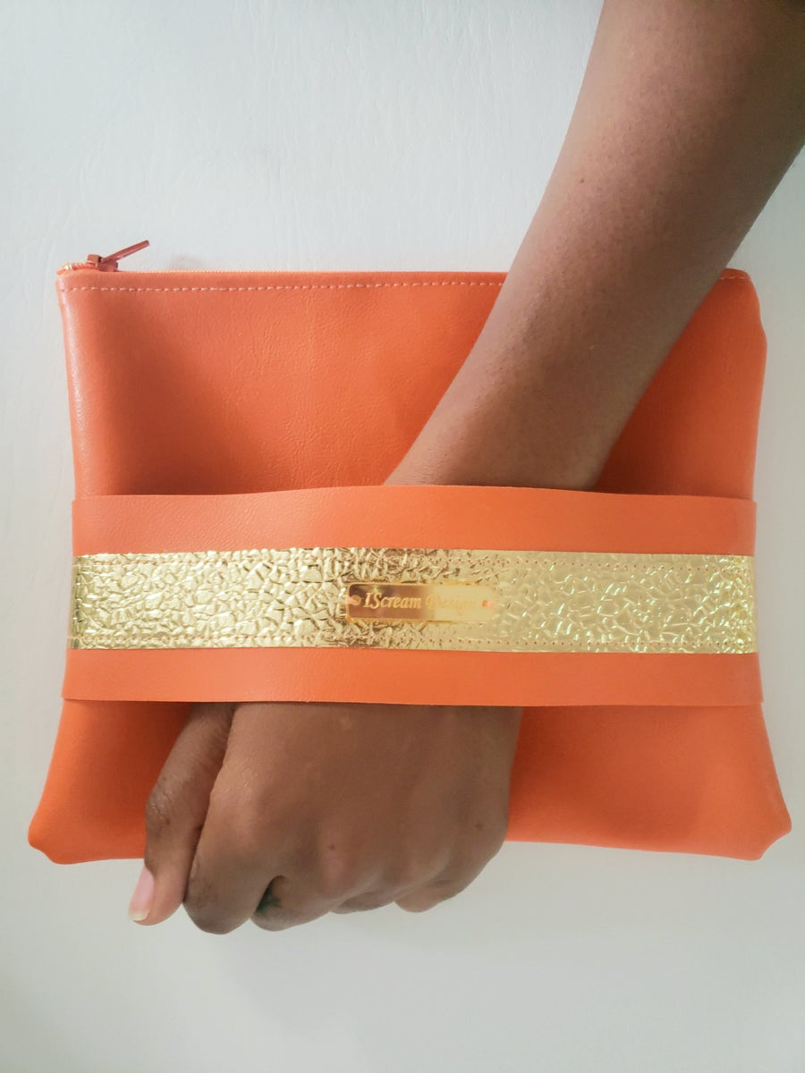 Image of Neon Orange Gold Clutch With Hand Strap