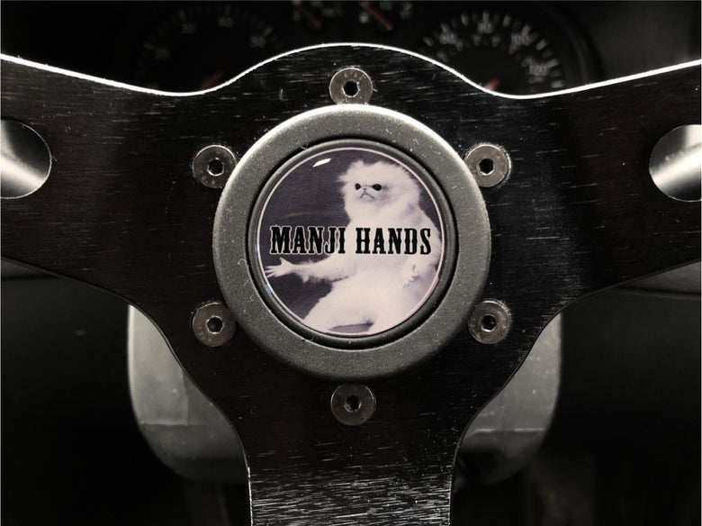 Image of Manji Hands Hornpush Sticker 40mm Domed