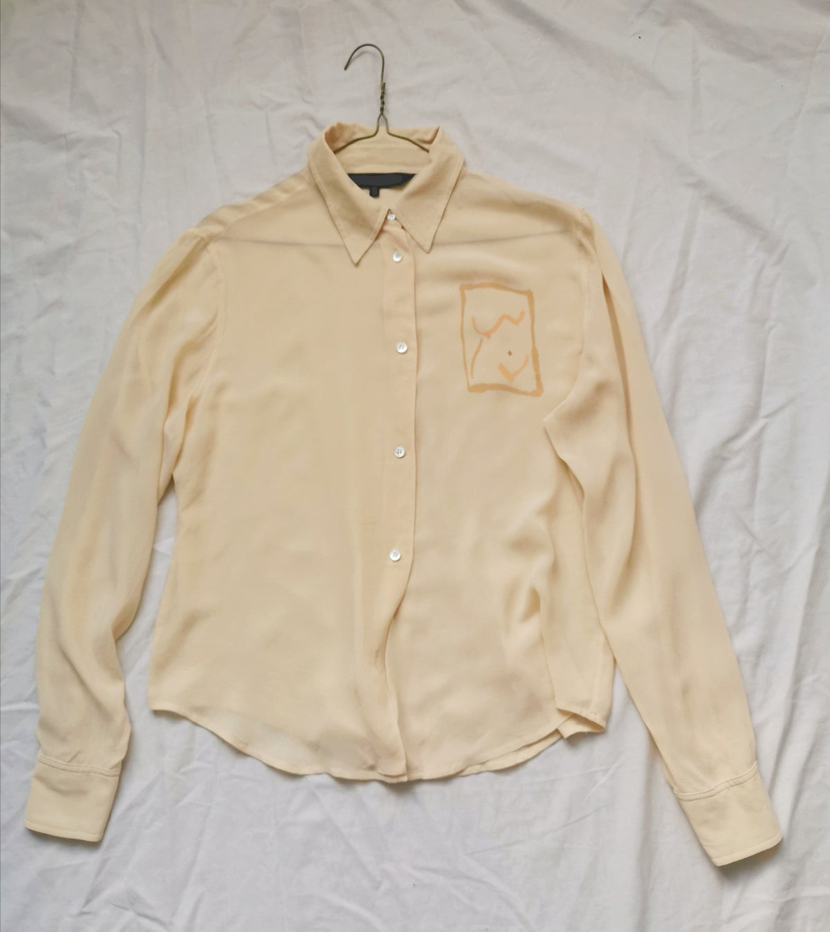 Image of pale gold blouse