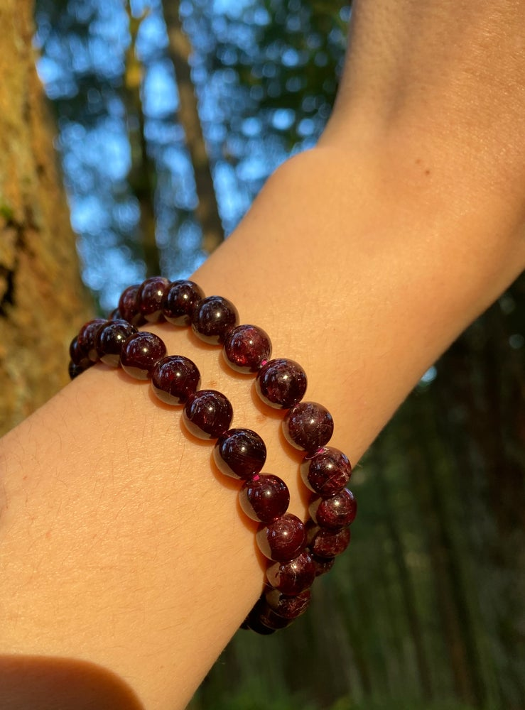 Image of garnet stretch bracelets