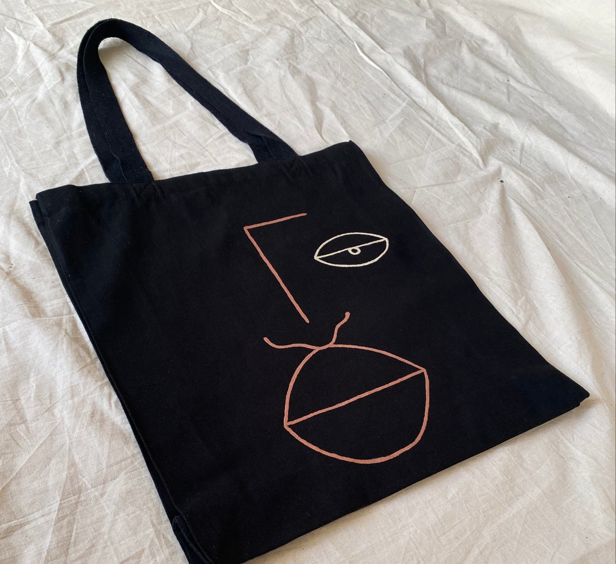 Image of eye face tote