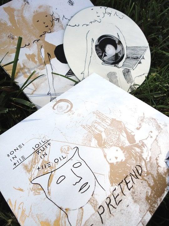 Pretend 'Bones In The Soil, Rust In The Oil' - Collector's Edition CD