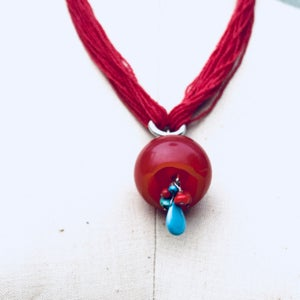 Red Bud on Vintage seed bead necklace