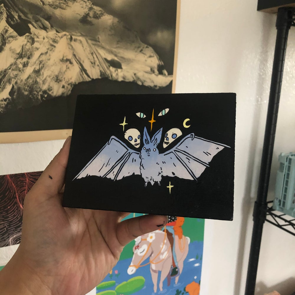 Image of Skulls with Bat Painting