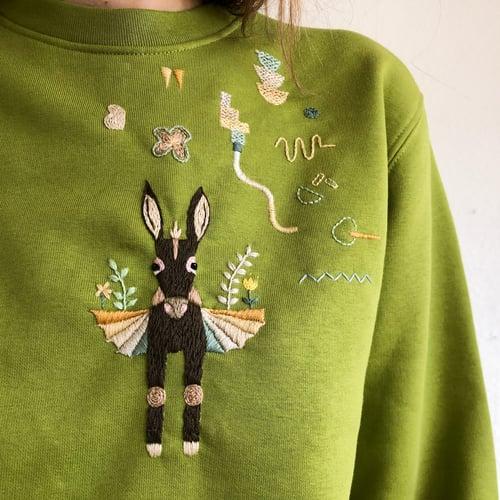 Image of The flying donkey - hand embroidered organic cotton sweatshirt, Unisex