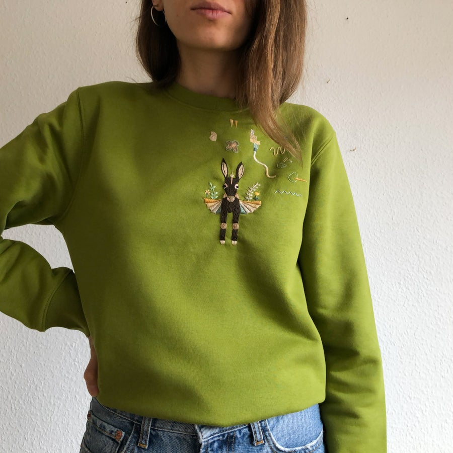 Image of The flying donkey - hand embroidered organic cotton sweatshirt, Unisex