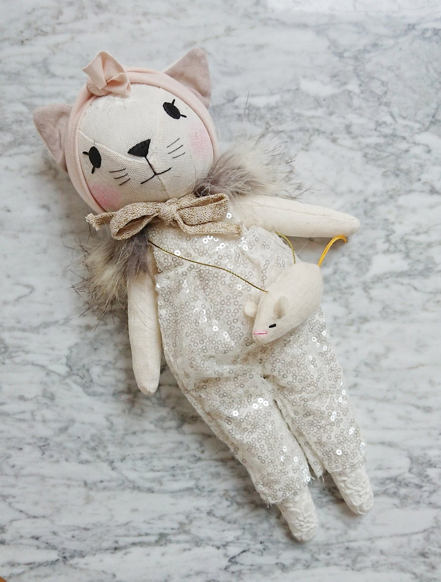 Image of Cat with sequin pants and mouse bag