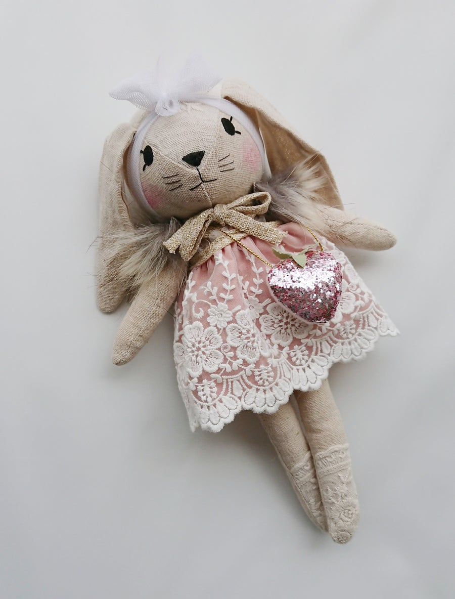 Image of Bunny in mauve dress with strawberry bag