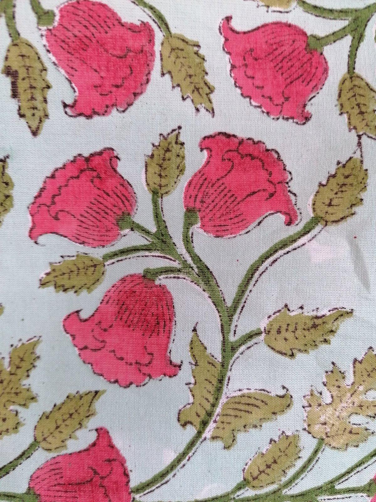 Image of Namasté fabric bleu pâle fleurs rouges