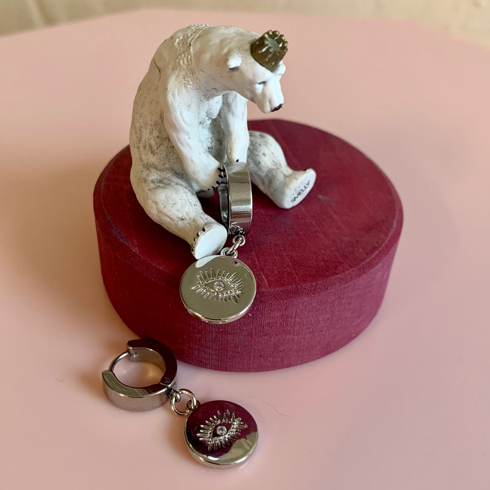 Image of Silver Eye Disc Huggie Hoops