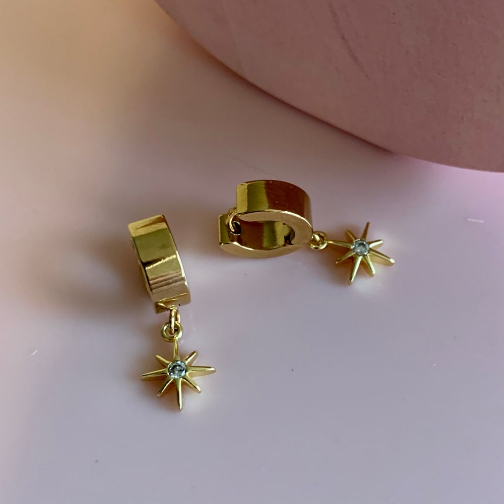 Image of Gold Pointed Star Huggie Hoops