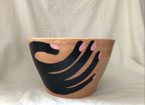 Image of hand on bowl