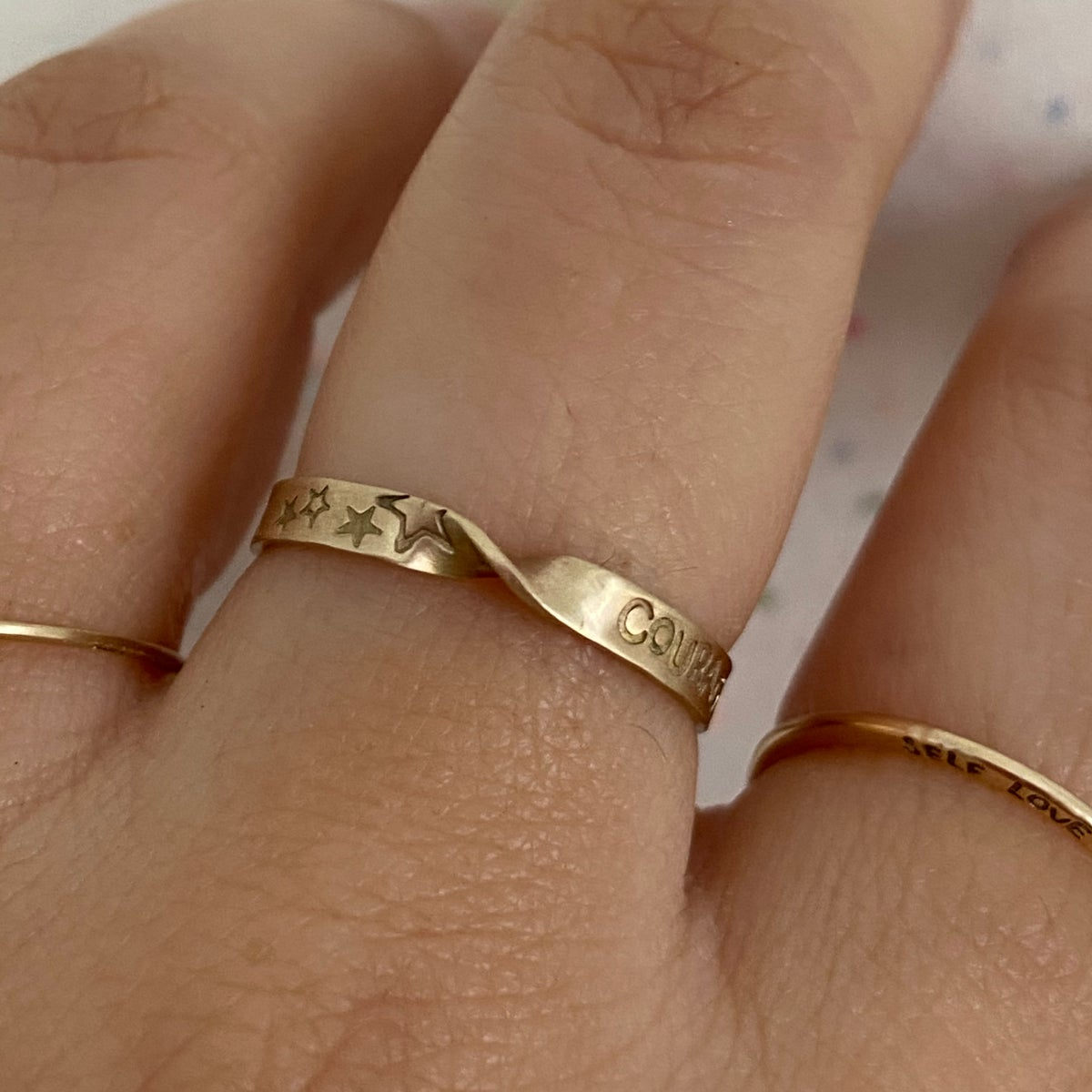 Image of Twisted gold ring with stars