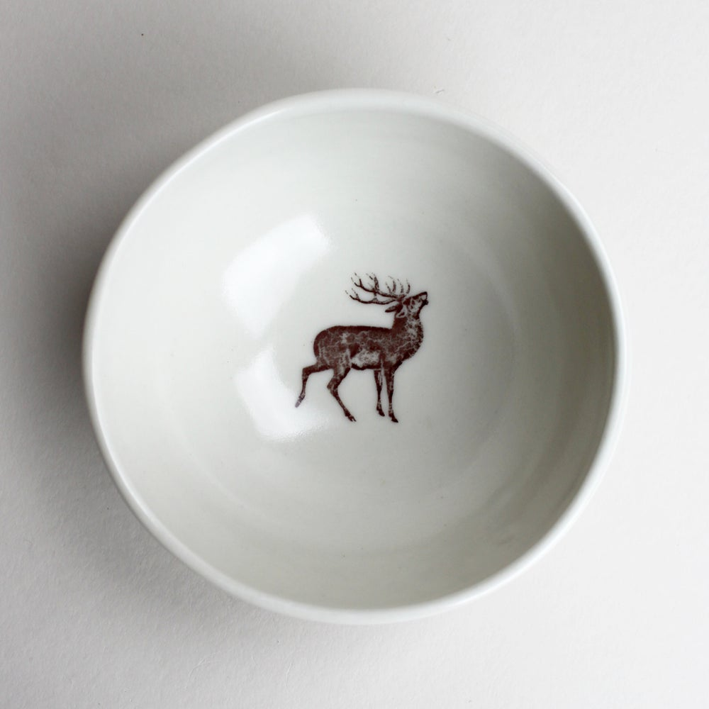 Image of roly poly bowl with stag deer, ivory