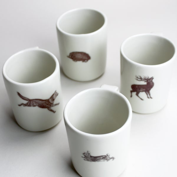 Image of set of four 10oz mugs, in the woods