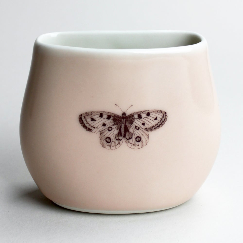 Image of pebble vase, rose, butterfly