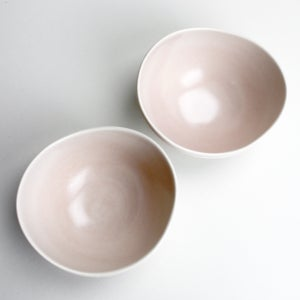 Image of organic roly bowls, set of two, eggshell outside, rose inside