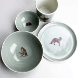 Image of happy lunch set: plate, bowl, cup in sage with woodland creatures