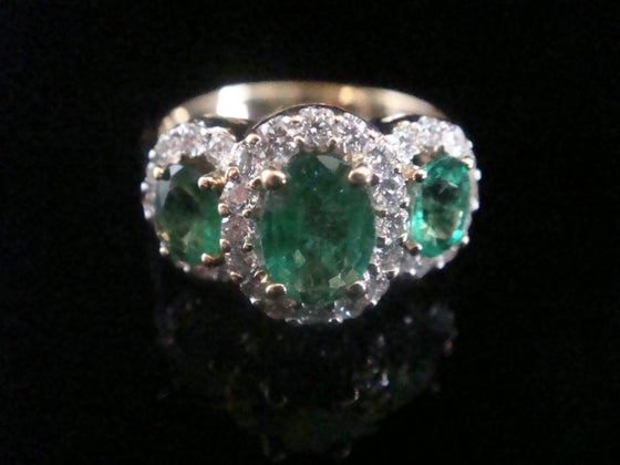 Image of MODERN FINE 18CT YG EMERALD DIAMOND 0.68CT RING VS2-SI1 AND H-I COLOUR 3 STONE