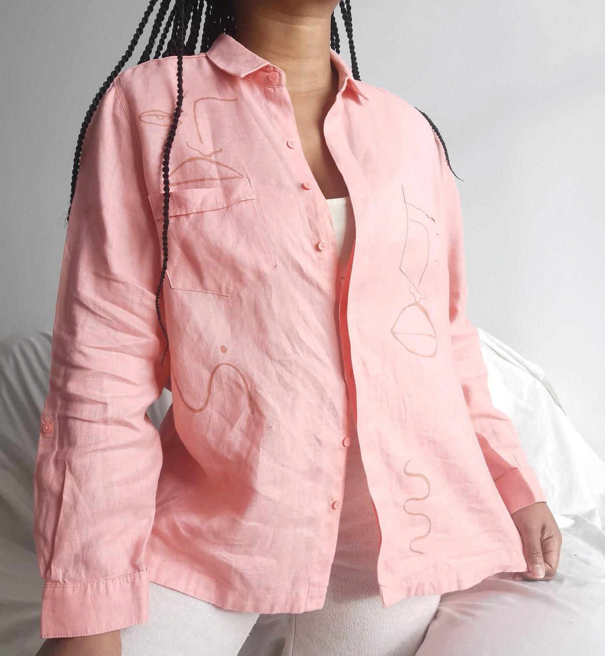Image of pink ting shirt