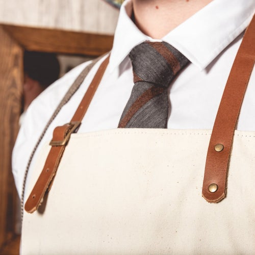 Image of Barber Apron in Canvas Cream Color with leather Pockets and Straps