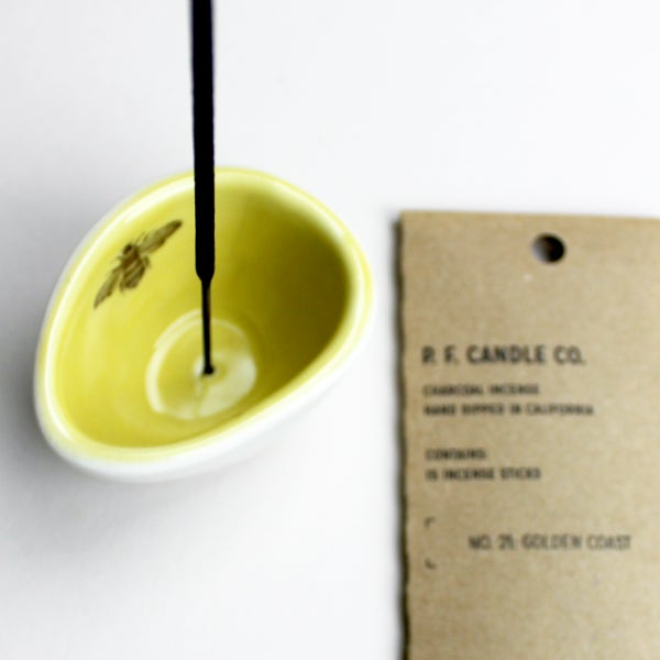 "Image of pebble incense holder, mustard with bee, plus yummy p.f. candle ""golden coast"" incense"