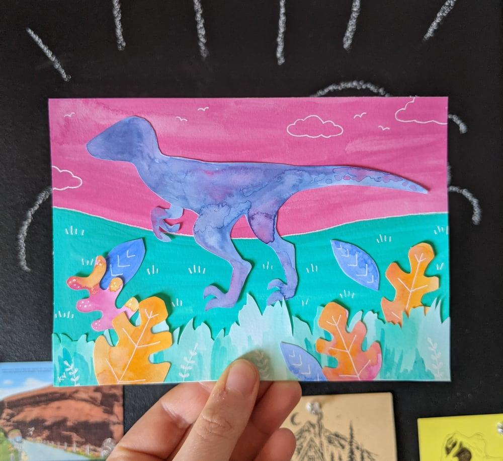 Image of Velociraptor cut paper