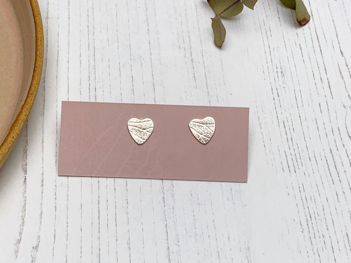 Image of Petal imprint heart studs, recycled sterling silver.