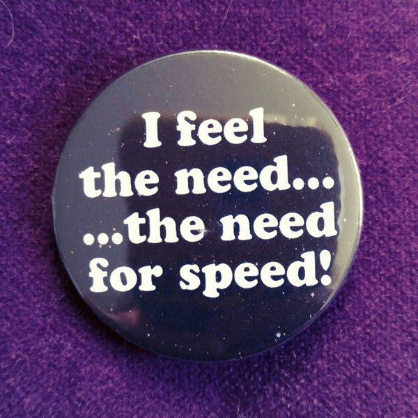 Image of badge top gun - the need of speed