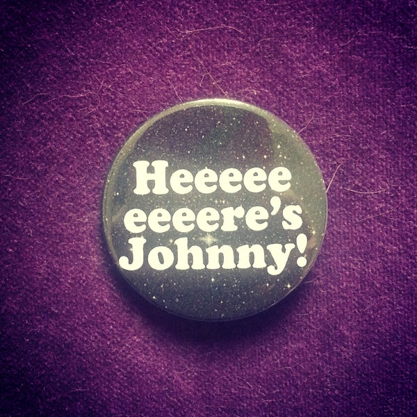 Image of badge shinning - here's johnny