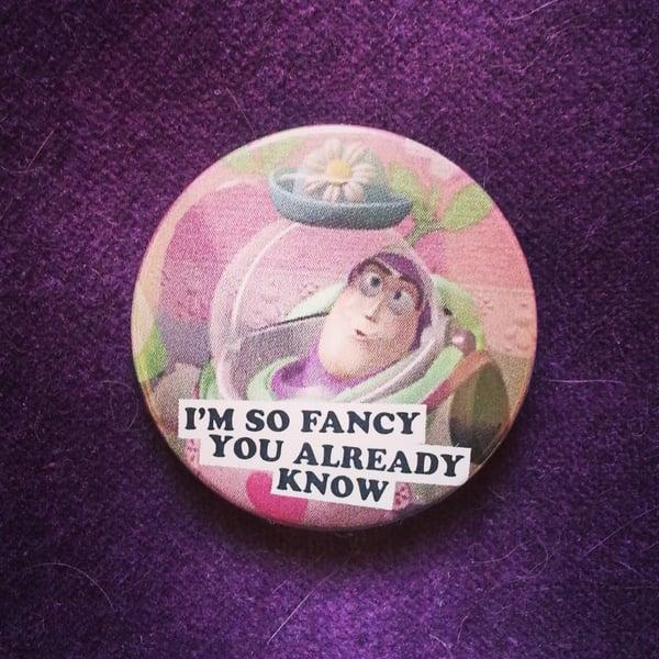 Image of badge toy story - mrs nesbitt