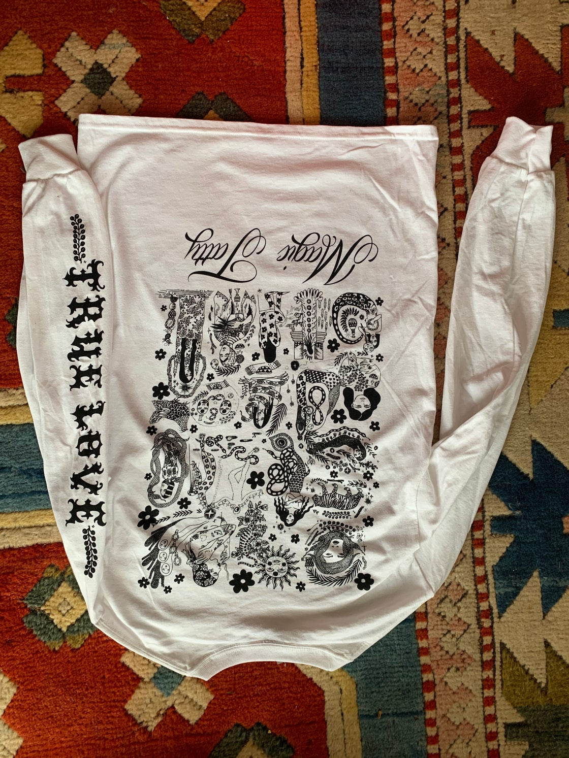 Image of WHITE CLOUD EDITION TRUE LOVE CONQUERS ALL LONG SLEEVE