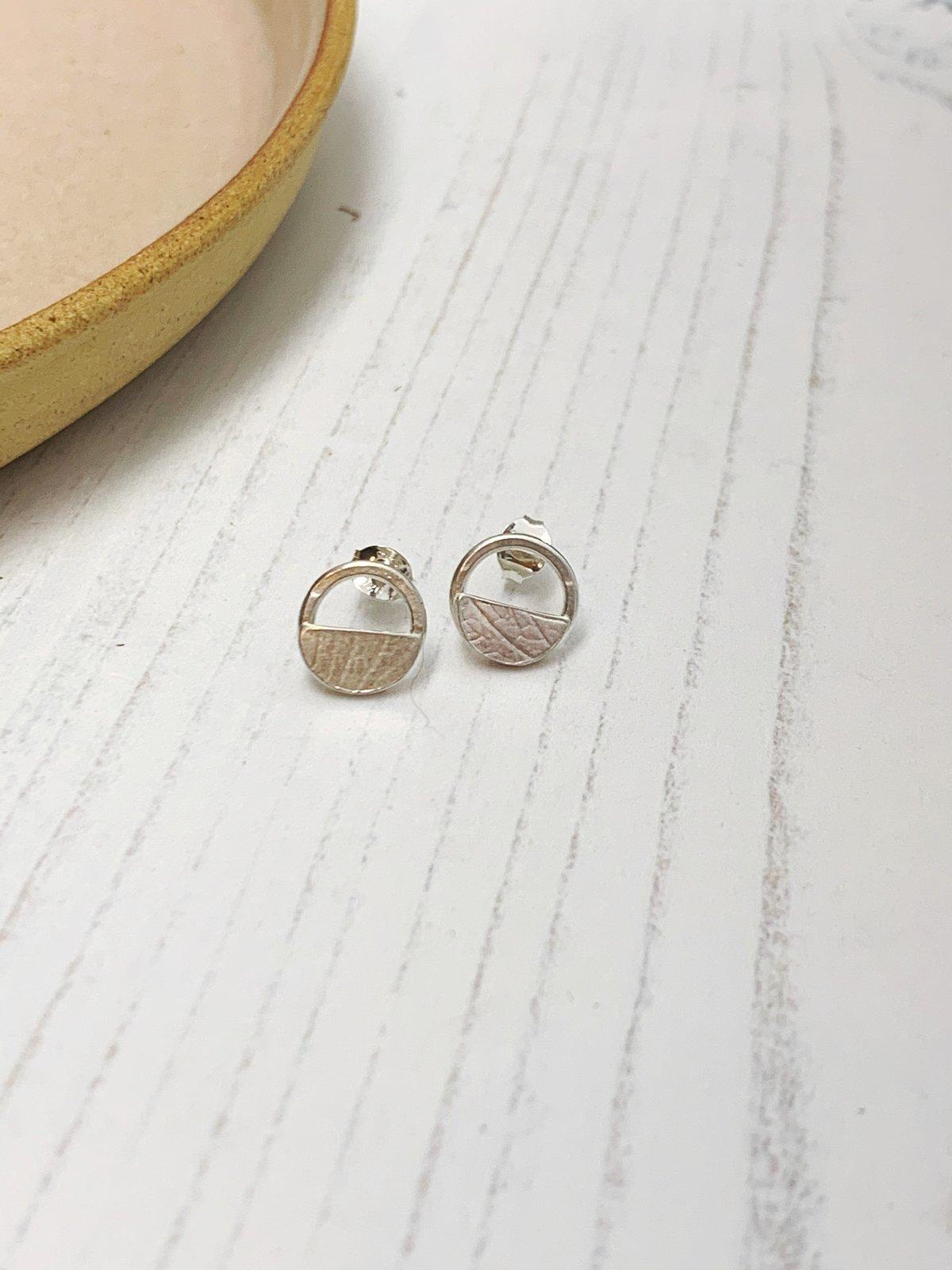 Image of Circle and semi circle stud earrings