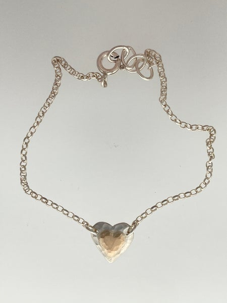 Image of Heart shaped silver bracelet with 9ct gold