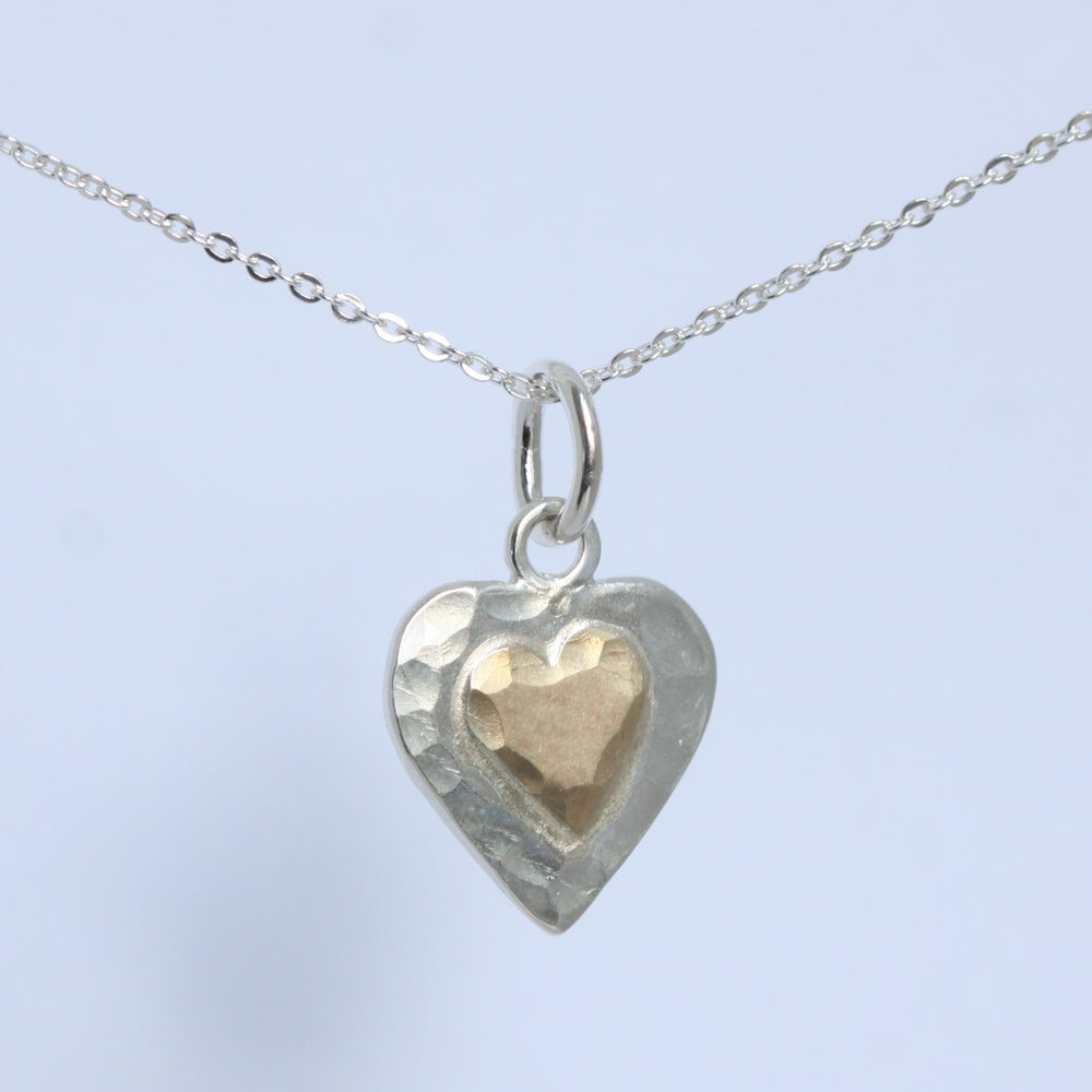Image of Heart shaped silver necklace with 9ct gold