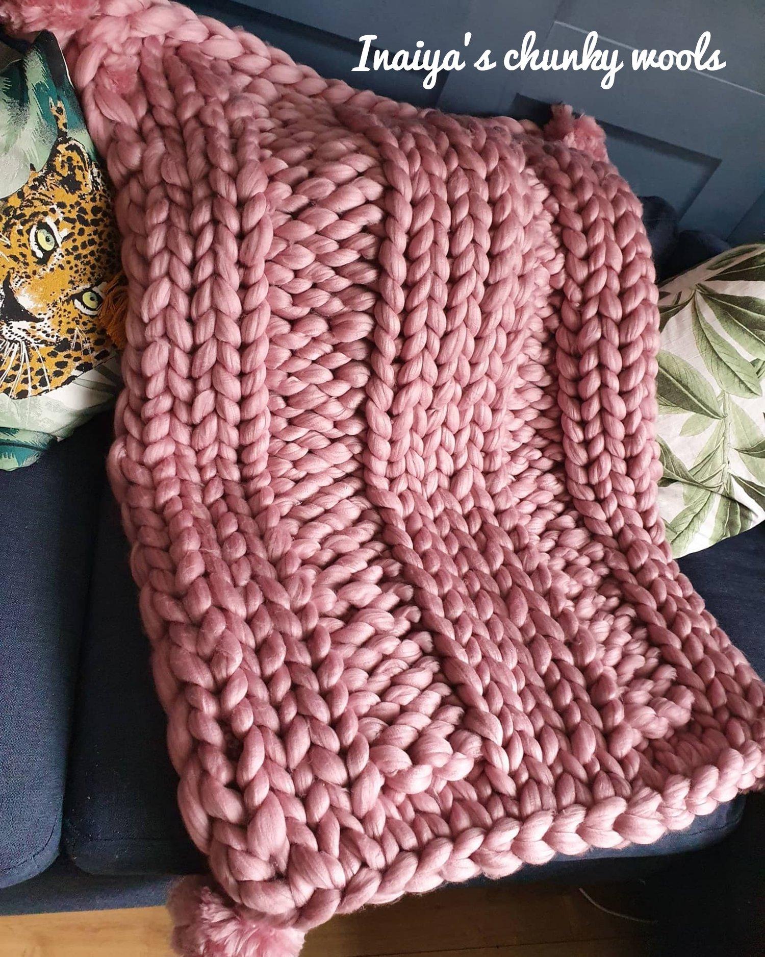 Image of Pink pom pom blanket