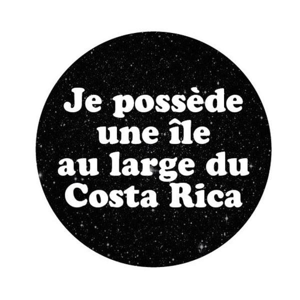 Image of badge jurassic park - costa rica